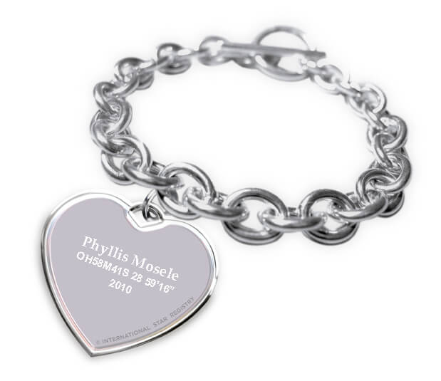 Tiffany-style sterling silver bracelet with heart shaped charm is engraved with the star name and telescopic coordinates