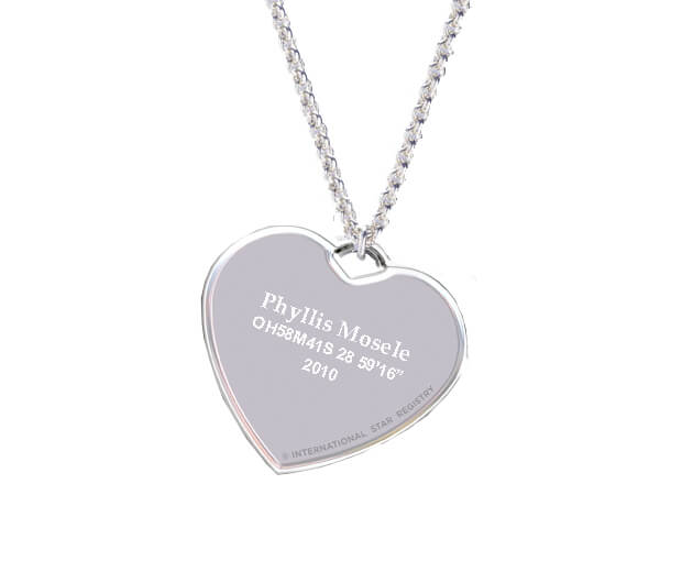 The star name engraved on a sterling silver heart-shaped charm with a simple, elegant silver chain.