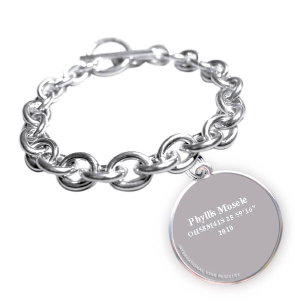 Solid sterling silver charm bracelet and round pendant engraved with the name of the star and its location in the sky.