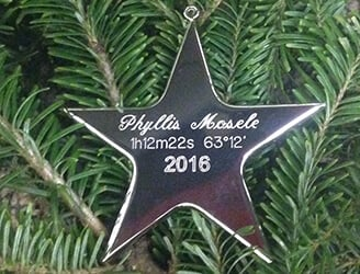 "This personalized Christmas ornament can be part of your family tradition. The ""Silver Star"" shows the star name and date"